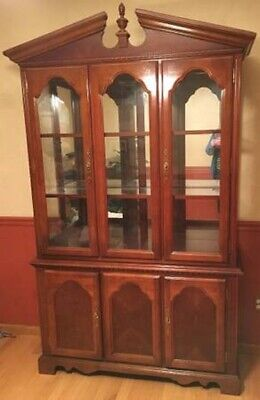 """Cherry-finish China Cabinet-50"""" w;15"""" d;83"""" h;ornate pediment and finial;2-piece"""