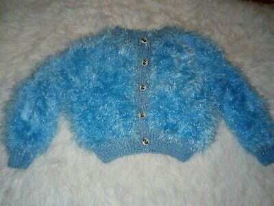 "Brand new hand knitted blue baby Girls Cardigan in fluffy wool Size 22"" Chest"