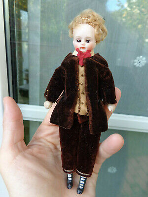 Antique dollhouse doll mignonette with closed mouth chocolate brown velvet dress