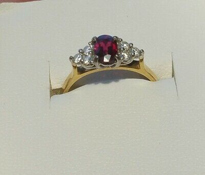 18ct solid gold ruby and diamond ring