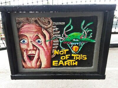 Not of this Earth wood carved poster