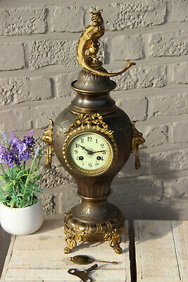Antique French metal brass lion heads gothic dragon animal clock