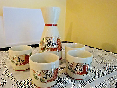 Vintage Japanese Porcelain Sake Set with Four Cups Marked Front and Bottom