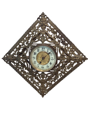 BRITISH UNITED CLOCK COMPANY, Detailed Brass Frame, Enamel & Gold Face, 1890's