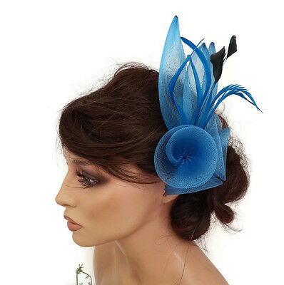 Blue Fascinator on a Hair Comb Slide in Mesh net with Black Feather