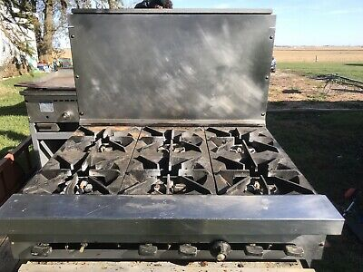 SunFire 6 Burner Commercial Gas Range and Standard oven. Good condition.