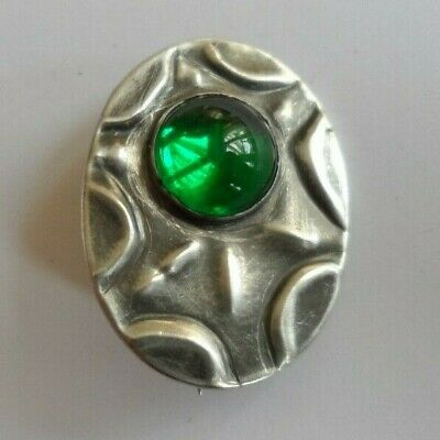 Antique/vintage, Art Nouveau oval pewter brooch set with a green glass stone.