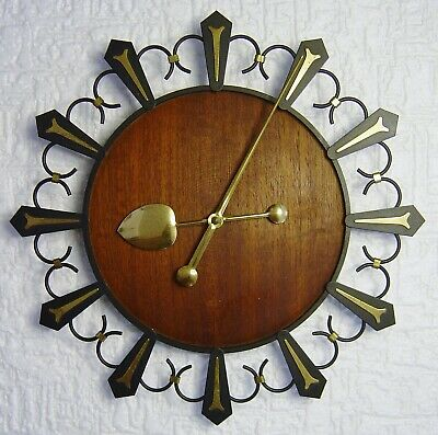 mid century Teak and black metal wall clock with brass parts Danish Modern