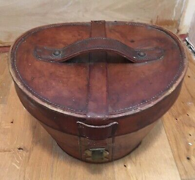"""Antique Leather Hat Box - 11"""" tall x 12"""" x13"""" at top with red interior."""