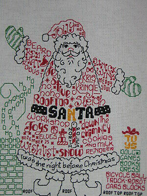 SANTA WORD PLAY. Finished counted cross stitch.