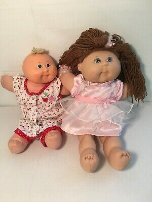 Two Cabbage Patch Dolls 1 Brown Haired With Original Dress 1 Blonde Newborn
