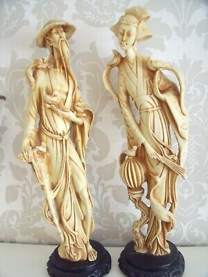 """VINTAGE RESIN CHINESE FIGURES""---------MAN AND WOMAN HOLDING BIRD,s....."