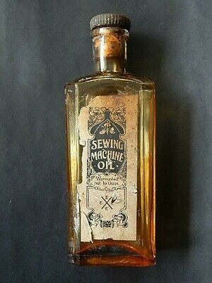 """Vintage Sewing Machine Oil Glass Bottle With Label - 8"""" High - Circa 1900"""