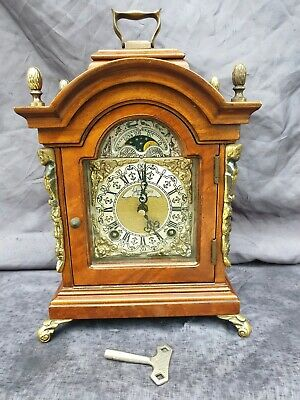 "Nice "" wuba warmink "" nut wood table / bracket clock."