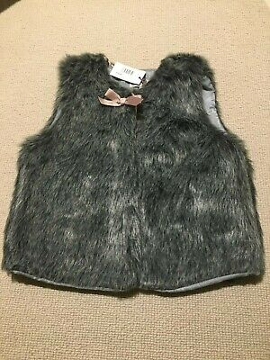 BNWT.  Lily Rose (Trotters) girl's faux fur Millie gilet. Size 4/5