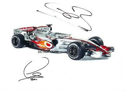 LEWIS HAMILTON ,JENSON BUTTON , A4 handsigned by both
