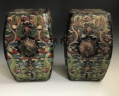 A Pair Of Antiqued Chinese Dragon Lacquered Garden Stools
