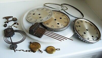 Collection of vintage clock parts.