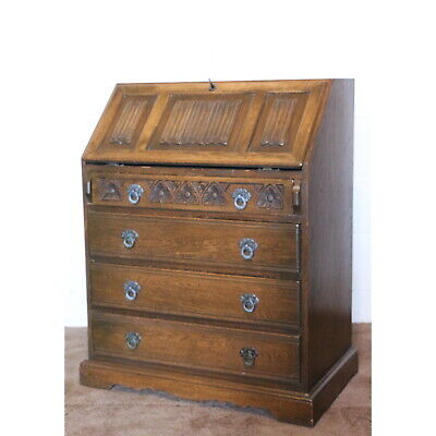 An Old Charm Carved Oak Bureau with Fitted Interior and Four Drawer Base