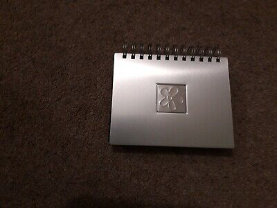 16cm x 10cm Slipin Photo Album Holds 48 Photos Silver front and velvet back.