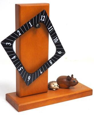 Mahogany interesting mystery novelty mantel clock dial spins to read the time
