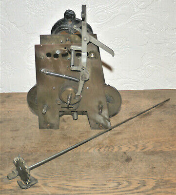 """Vintage clock movement; size height 7 1/2"""", width 7 3/4"""", depth 4 ¾""""; weight, 3."""