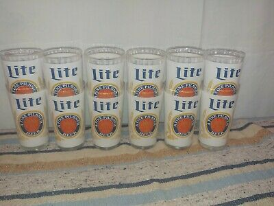 Set of 12 Miller lite glass tall beer vintage.. 12oz excellent condition