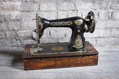 Old sewing machine with wooden base and small cache inside