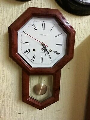 (945) POLYGON SHAPED BROWN IN COLOUR WALL CLOCK MADE BY WELLINTON CLOCK Co (UK)