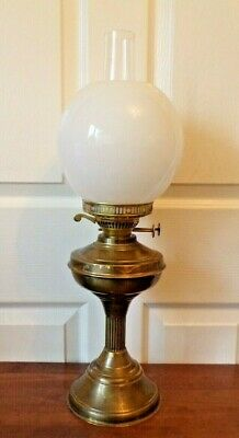A vintage brass Duplex oil lamp  twin burner  working order & white glass shade