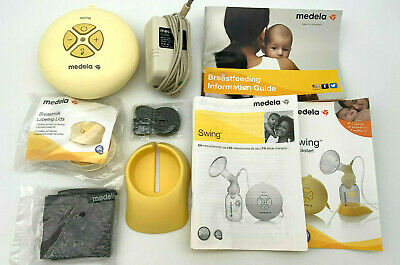 Medela-Swing Breast Pump With Accessories And Manual