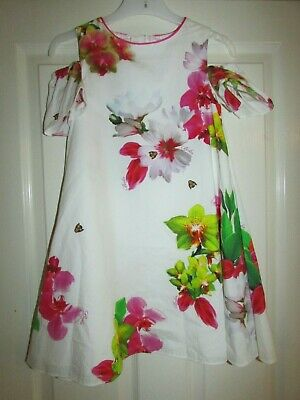 girls gorgeous white floral design cold shoulder dress from Ted Baker age 8yrs