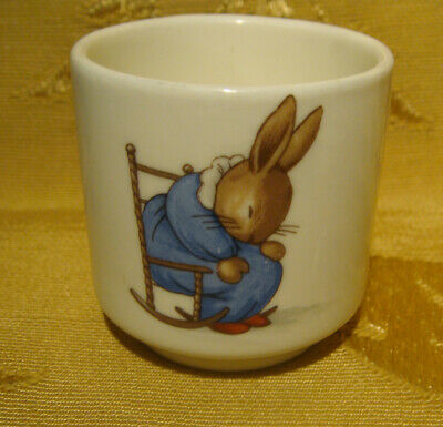 ROYAL DOULTON BUNNYKINS EGG CUP 'RAISING HAT' and 'SLEEPING IN ROCKING CHAIR'