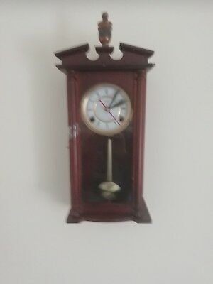 (425)  Small Wooden Long Case Wall Clock Made By Highland With Quartz Battery Mo