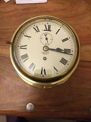 A late 19th Smiths empire brass ships wall clock in Excellent condition.