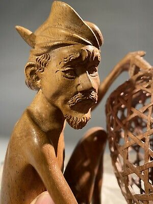 Man With Fighting Cock In Basket Hand Carved Tantra Gallery Njana Tilem
