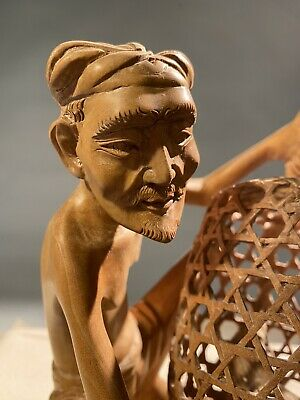 Man With Roosters In Basket Hand Carved Tantra Gallery Njana Tilem
