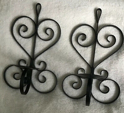 A Pair Of Black Wrought Iron Pillar Candle Wall Sconces