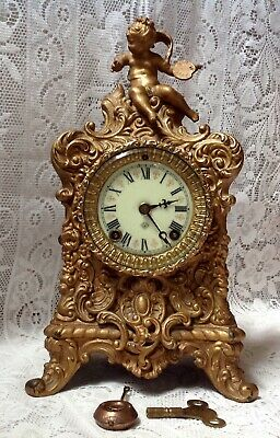 Ansonia Antique Striking Mantel Clock,  Gilted Metal With Cherub American Made