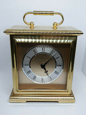 london clock company brass carriage clock with roman numerals & black hands.