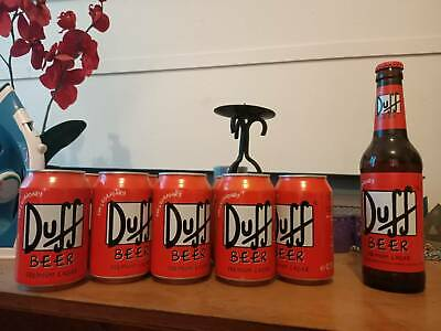 The Simpsons Duff beer cans stubby and fridge. Made in Germany. $500 for the lot