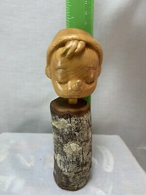 Pinocchio Carved Head Mounted on Wood branch Stand