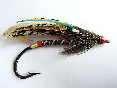 An Early 20Th Century Gut Eyed Black Doctor Size 7/0 Salmon Fly