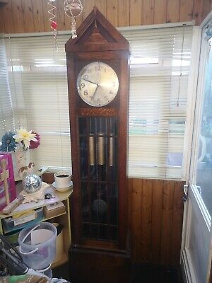 Antique Grandfather Clock Triple Chime. Working order for light restoration