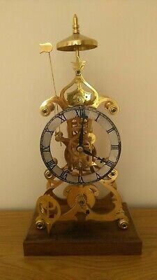 SKELETON CLOCK - Scroll frame with mainspring winder designed by John Wilding F.