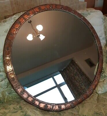 Antique Large circular copper framed mirror on chain good condition