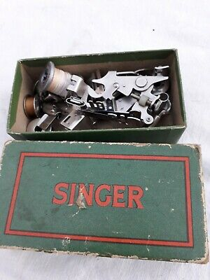 vintage SINGER sewing machine feets and bobins
