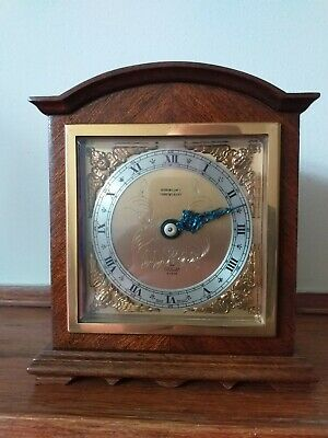 Vintage Elliott mantel clock made in walnut and mahogany with French escapement.