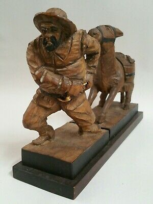 Vintage hand carved wood man and stubborn mule donkey