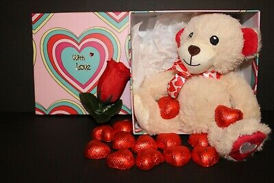 Valentines gift, soft Teddy bear, in a box with heart chocolates, and a rose